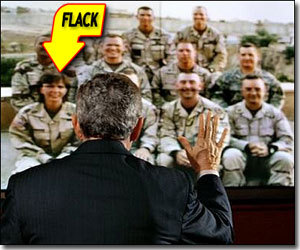 george bush and the soldiers, one of whom appears to be a military PR flak